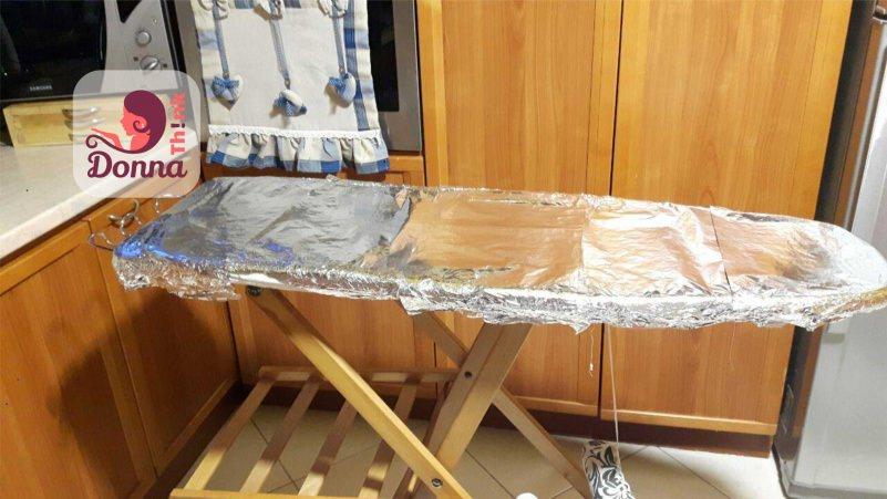 asse da stiro superficie fogli alluminio cucina