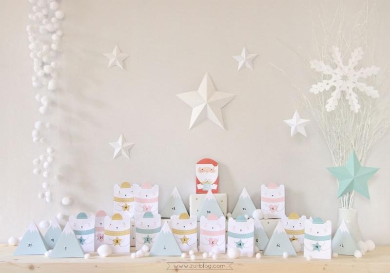 Quanto manca a Natale? Prepara il Calendario dell'Avvento fai da te e inizia il conto alla rovescia sagome orsi polari montagne azzurre piramidi sfere bianche babbo natale stelle rami secchi fiocco di neve