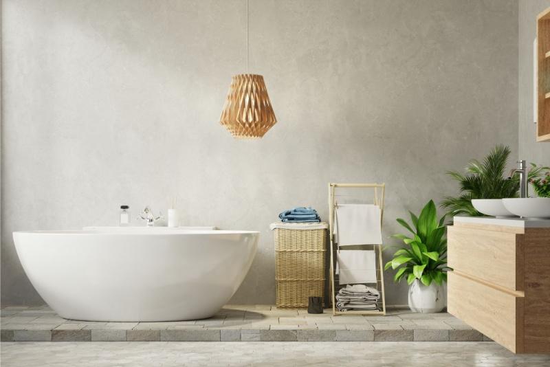 vasca da bagno stile moderno cesta vimini vaso ceramica pianta foglie verdi