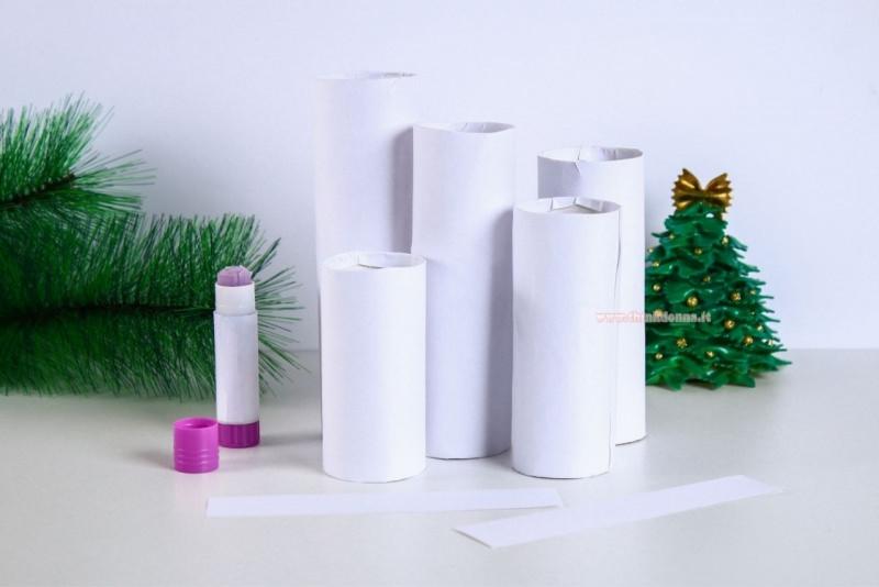 tutorial candele fai da te colla stick carta bianca rotoli cartone ramo abete