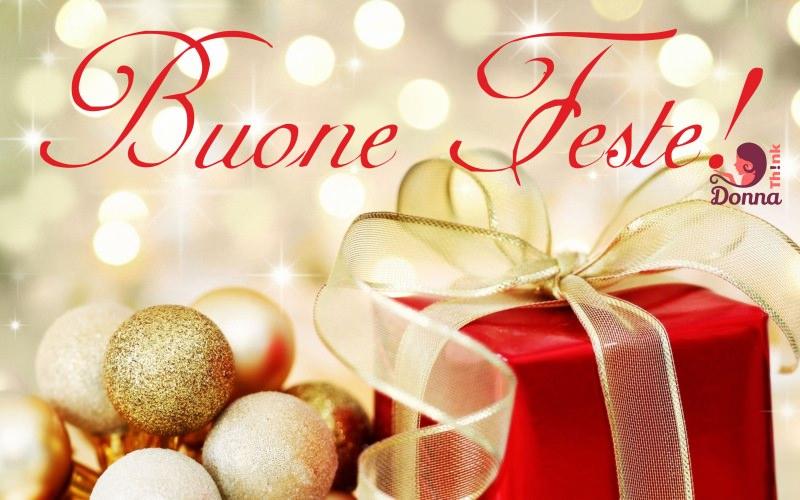 buone feste natale pacco regalo rosso fiocco oro dorato decorazioni palline natalizie oro dorate glitter