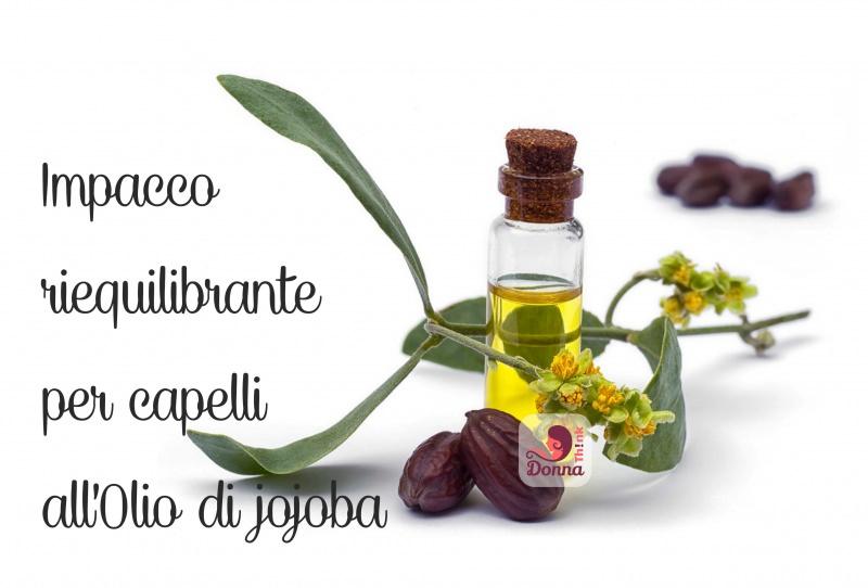 ampolla con olio di jojoba fiori foglie tappo