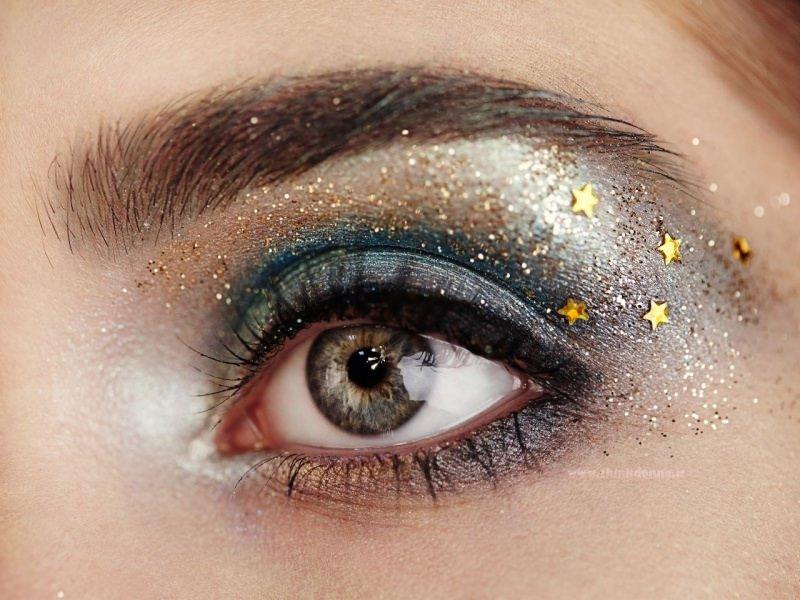 occhio azzurro grigio trucco festa makeup glitter stelline