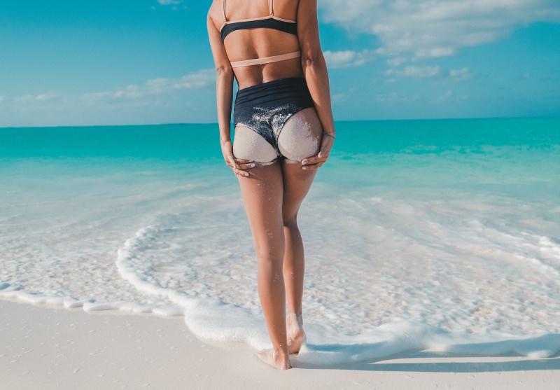 mare estate sabbia corpo donna scrub